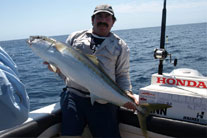 Skipper John Gooding with a solid King Fish